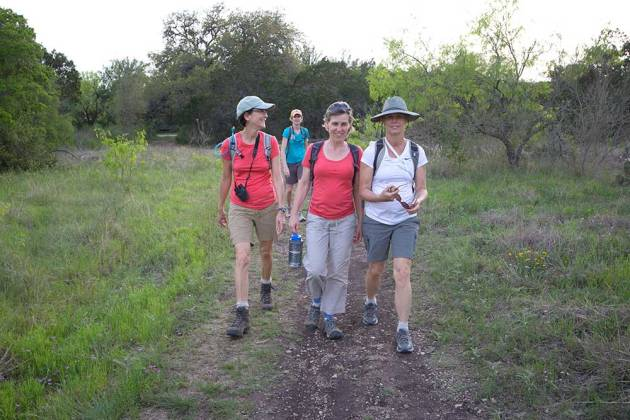 Suzanne, Maria, Bettina and Kelly hiking along the Far Reaches Trail.